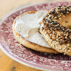 everythign bagel with cream cheese on a plate